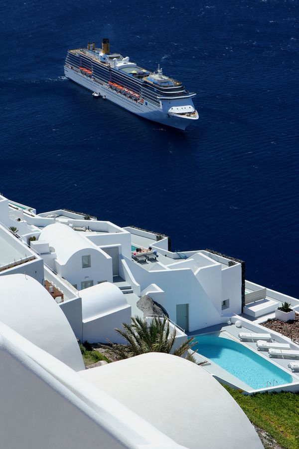A Royal Caribbean cruise ship coming into Santorini, Greece. Contact us.