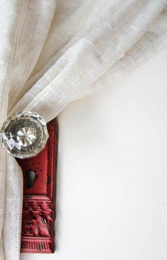 Crystal doorknobs work wonderfully as curtain tiebacks.