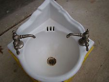 We probably won't have a corner bathroom sink, but this is fabulous—almost a reason to opt for one. (eBay description: Vintag Victorian Sculpted Corner Mount Cast Iron Porcelain Bath Sink orig Faucets)