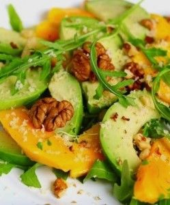 MANGO AVOCADO AND ARUGULA SALAD: 1 medium mango, 1 medium avocado, 1 tablespoon lemon or lime juice 1/4 to 1/2 cup pecan halves, as desired A big handful or two of baby arugula leaves, as desired 2 tablespoons unsweetened coconut flakes, optional