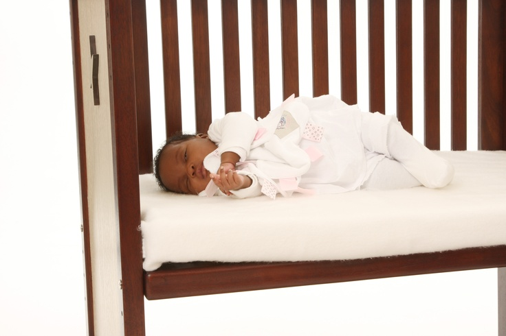 Little one in our co-sleeper crib with a Taglet