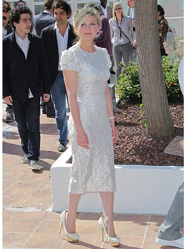 Kirsten Dunst wearing white Dolce and Gabbana dress at cannes film festival. I love her.