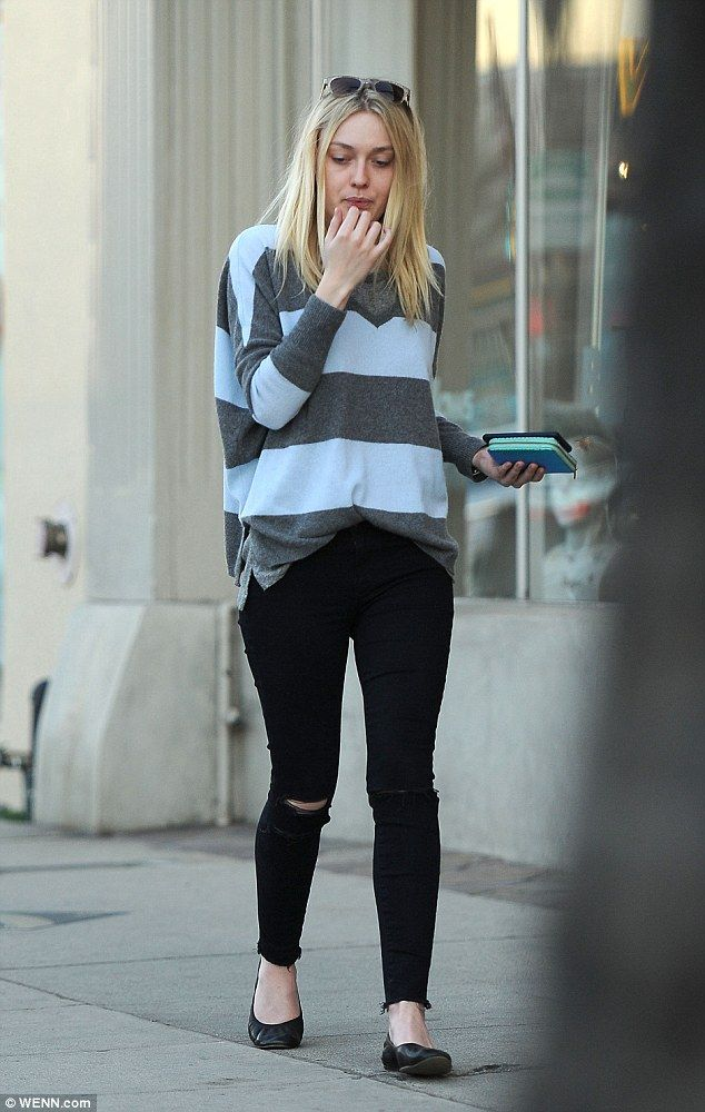 Day of beauty: Dakota Fanning strutted down the street in a pair of skinny jeans ripped st...