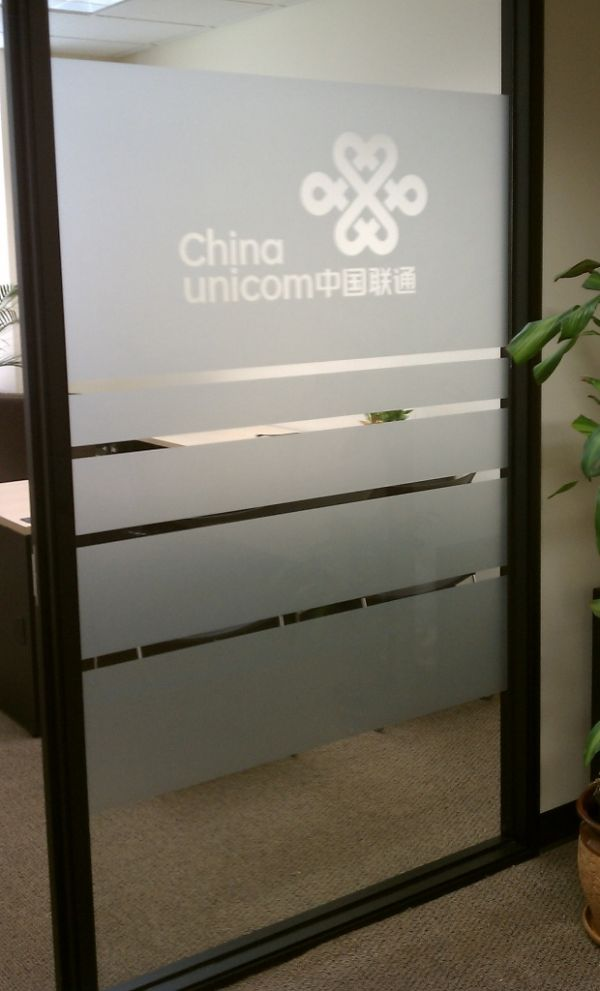 Vinyl window graphics ideas using frosted or etched glass for Office window ideas