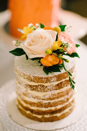 Vanilla Pod naked layer cake topped with fresh flowers.jpg
