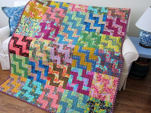 From the book 'Cultural Fusion Quilts' by Sujata Shah.  This block is made with  free-hand slightly curved seams.