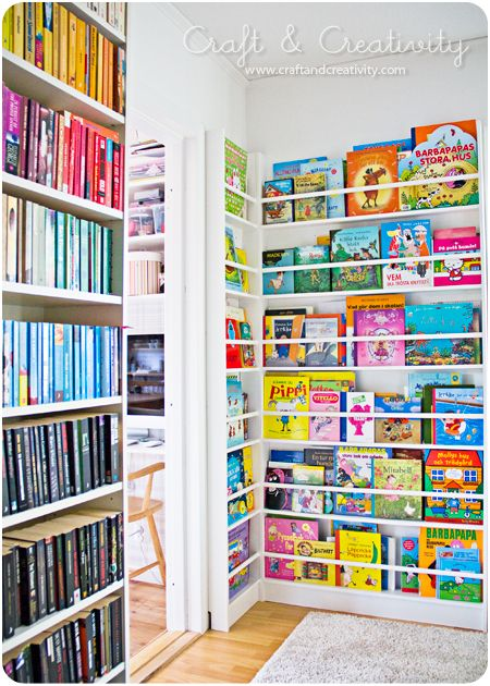 DIY bookshelf for kids - shows more of the covers than using IKEA spice racks to get the same look