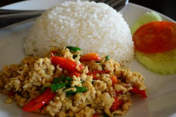 Stir Fried Minced Chicken in holy basil with rice. Hot and spicy dish in thai.