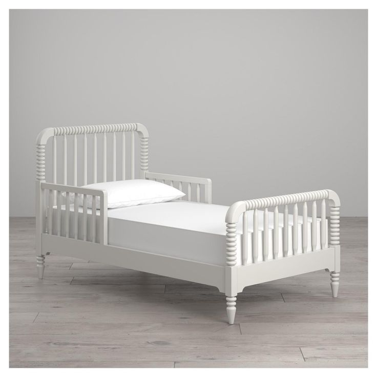 The carved solid wood frame on the Rowan Valley toddler bed is a style derived from classic Victorian children's furniture. Each turned spindle leg and slat is painted with a durable, non-toxic, water-based paint finish. Available in white and black finishes to coordinate with the entire Rowan Valley collection. Mix and match your pieces to create a one-of-a-kind space for your child as they grow. Like all Little Seeds products, this purchase helps support a major environmental initiative...
