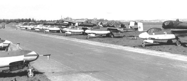 Line up of Heinkel He 162 Volksjager (People's Fighter) aircraft at Leck during the surrender, WWII.  There were 120 He 162s at the time of Germany's surrender during WWI.