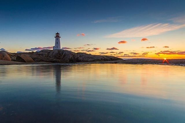 The last kiss of the sun at Peggy's Cove.|| Featured Photo by…