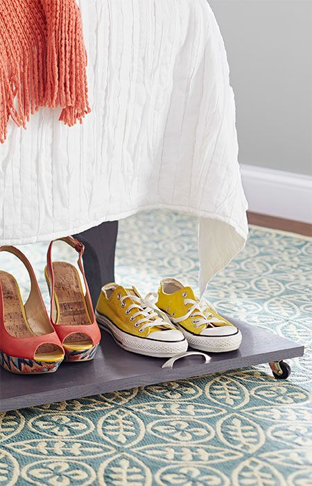 Shoes stay organized but roll out of the way on this under-bed storage platform.