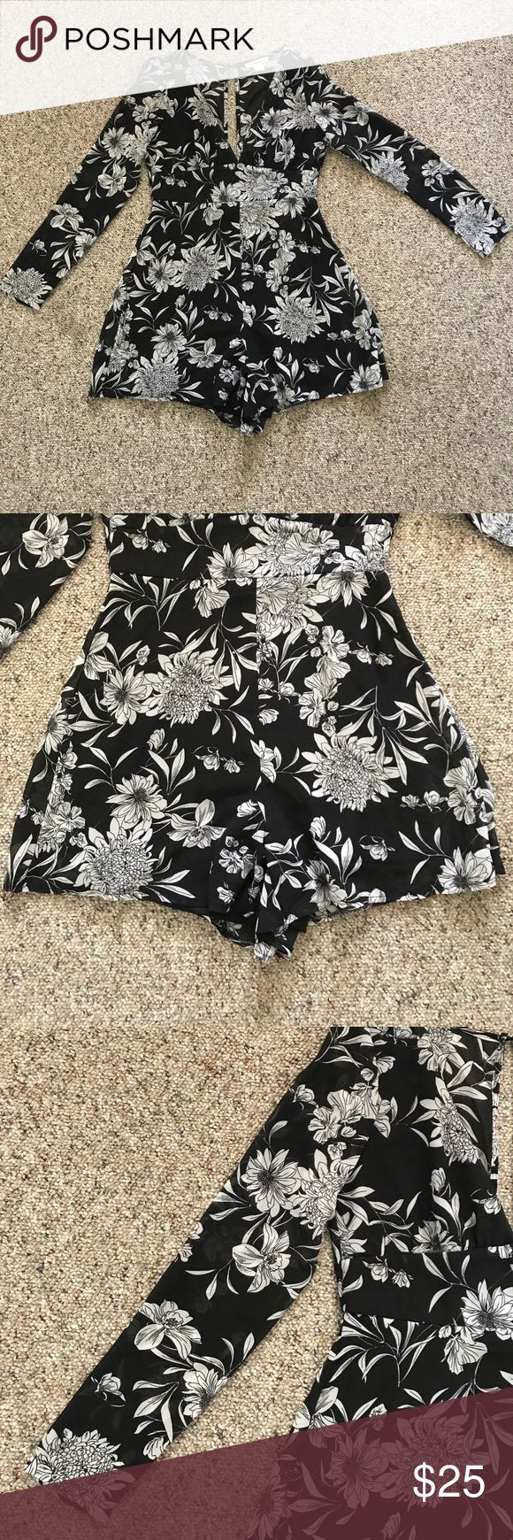 Black & white floral Romper Black and white Romper with floral design. Long sleeve with sheer arms. Back has a slit and it zips up with a button at the top. glamorous pac sun Other