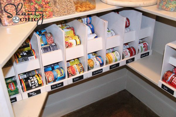 Use plywood and scrap lumber plus a few nails and a big of gorilla glue, and make your own individual canned food organizers that stores your cans, and rotates the cans to allow you to use the older dates first.