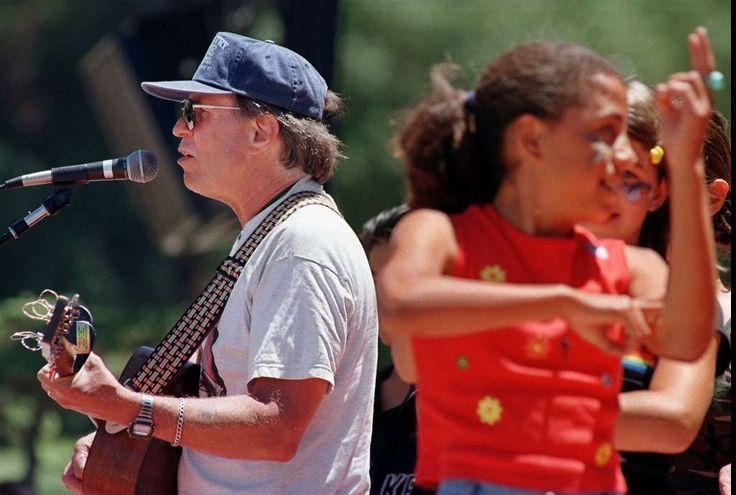 """June 21, 1997 - Country Joe McDonald, left, an anti-Vietnam War protester and 1960s rock icon, sings """"Carry On,"""" a healing song of peace, during San Francisco's 30th anniversary celebration of the """"Summer of Love."""" Photo: Robin Weiner, Associated Press"""