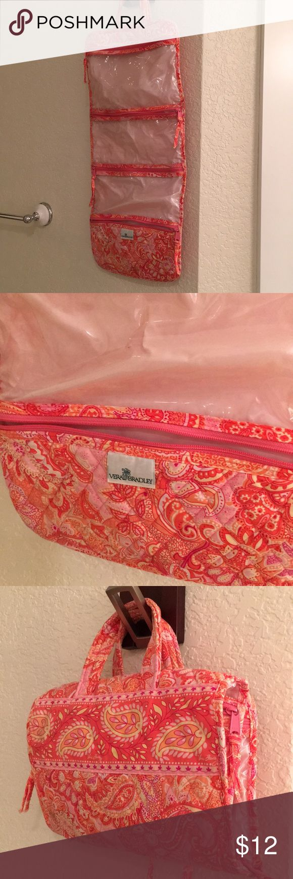 Coral pink Vera Bradley travel toiletries case Some marks on the inside plastic that I'm sure will come off if you took soap to it. Vera Bradley travel case with four different pouches/compartments. Vera Bradley Bags Travel Bags