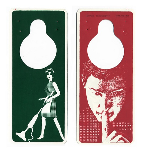 A collection of over fifty unique hotel door hangers