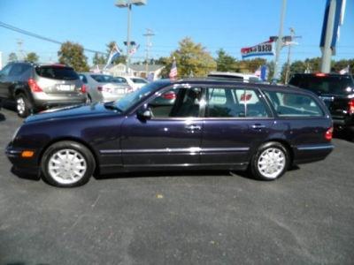 2001 Mercedes-Benz E320 4MATIC. It's purple 3rd row seat!!!