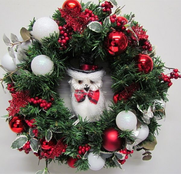 A white owl is the star of this festive wreath by Miss Haberdash.