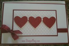 handmade valentine from Stampin' Mary ... three hearts cut from glitter paper ... embossing folder texture ... a bow ... lovely ...