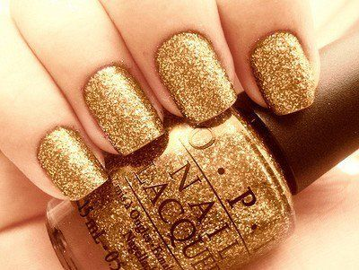 Gold nail polish---the perfect addition to any outfit.