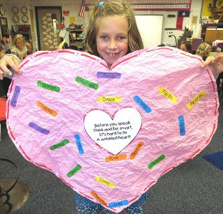 "Using Chrysanthemum to talk about bullying. Crush the heart every time bad words are said, then fix them with ""bandaid's"" with nice words."