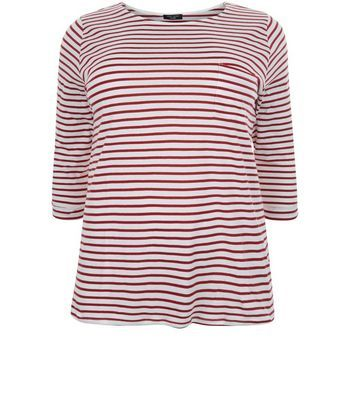 """Curves. Bring classic stripes into your everyday look with this red stripe 3/4 sleeve top. Team with skinny jeans and plimsolls for an effortless finish.- All over stripe print- Single pocket front- Rounded neckline- 3/4 sleeves- Casual fit that is true to size- Soft cotton fabric- Model is 5'9""""/180cm and wears UK 18/EU 46/US 14 Created for women of size 18 to 28/EU 46 to 56**Selected styles are available up to size 32/ EU 60"""