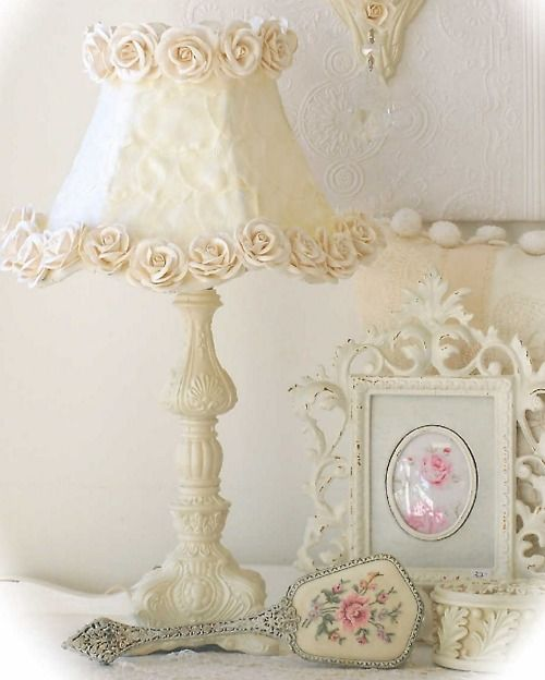 Paint a lamp base  ivory, add a shade, glue fabric roses all the way around. Gorgeous!