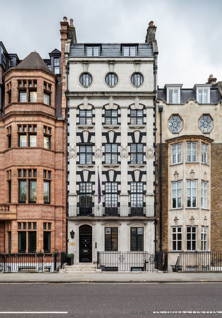 Built in 1780 and residence to Jane Austin's brother, Henry. 6-storey Portland stone townhouse converted into single office on Sloane Street. Black window frames.