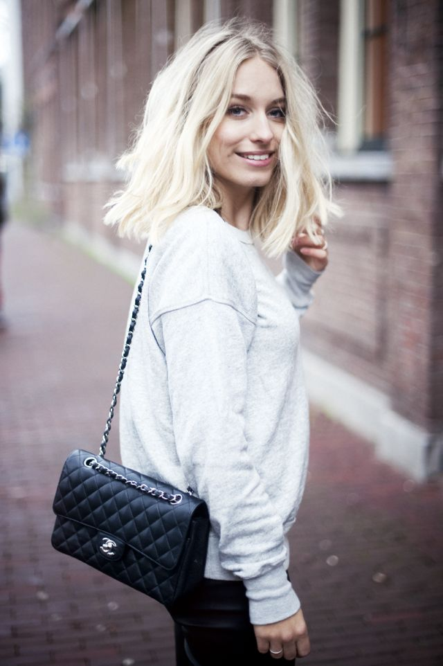 Black jeans, grey top, black bag