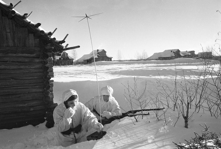 A Soviet radio operator makes a report to the regiment's headquarters from a small villageduring the Battle of Moscow. Moscow Oblast, Russia, Soviet Union. 1 December 1941.
