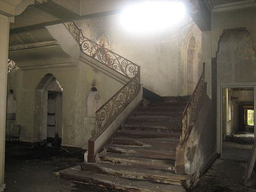 old abandoned stair case stairs falling apart fancy wooden vintage home house