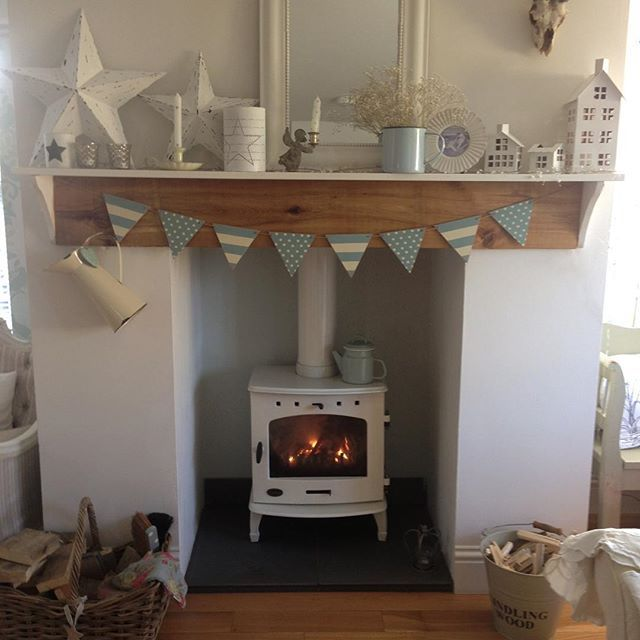 I've lit the fire , it's chilly here in Cornwall sunny but chilly brrrr !! #countryliving #cornwall #myhome #stove#bunting#woodburner #stars #coxandcox#vintage