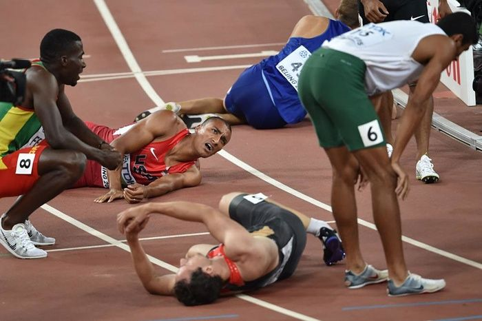 World Athletics Championships 2015: day eight – in pictures | Sport | Gold medallist Ashton Eaton, top left, lies on the track with Kurt Felix, left, Larbi Bourrada, right, and Kai Kazmirek, front centre, after finishing the last event of the decathlon, the 1,500m