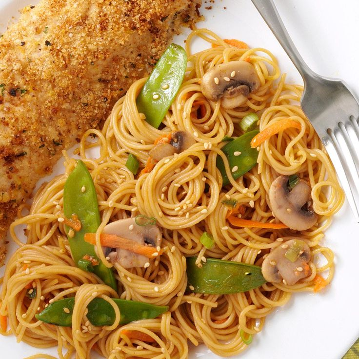 Asian Spaghetti Recipe -We love this recipe with its bright, crisp-tender snow peas and carrots, but you could easily substitute any veggies you have on hand. —Anne Smithson, Cary, North Carolina