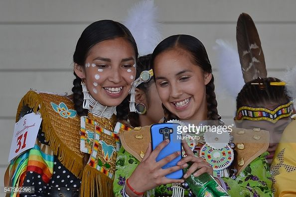 News Photo : Young members of the First Nations during a...