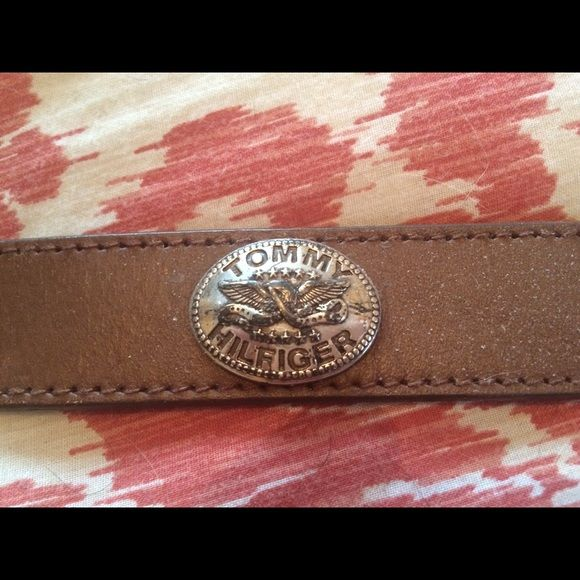 Tommy Hilfiger Leather  Belt Classic light brown belt by Tommy Hilfiger. Size 34 with Concho emblems all the way around. A little wear on the buckle. Very cool! Tommy Hilfiger Accessories Belts