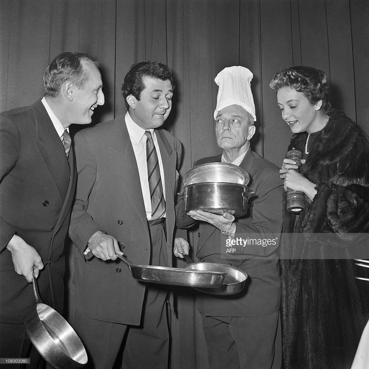 US actors Buster Keaton (2nd R) jokes with French actors Bourvil (L) and Pierre Richard (2ndL) and French actress Gisèle Pascal before his show in a Parisian circus, on January 7, 1954.