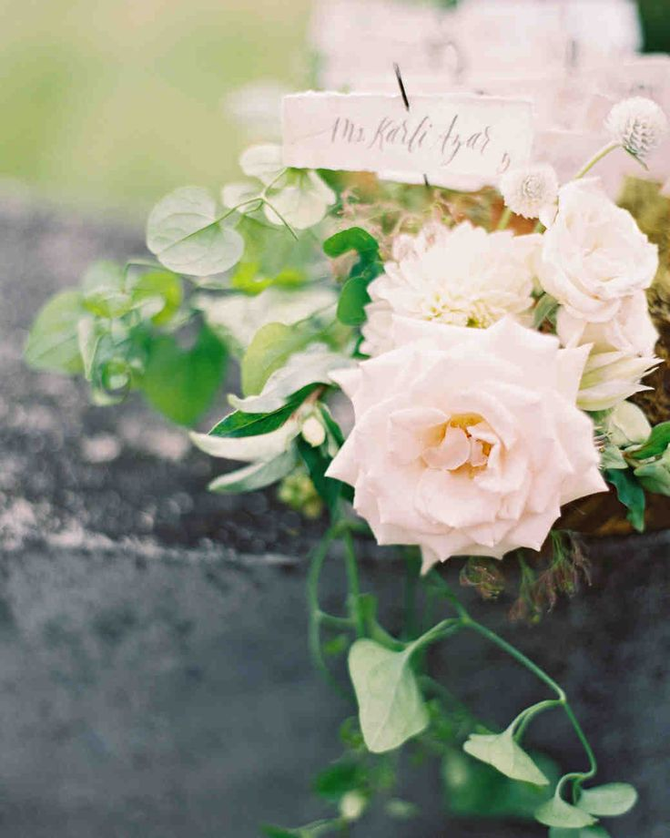 An Intimate Garden Wedding at a Michigan Bed & Breakfast | Martha Stewart Weddings - As escort cards, the bride calligraphed guests' names on handmade paper, then stuck them in vintage sewing drawers with overgrown moss and loose organic blooms. #weddingideas #seatingcards #calligraphy #weddingflowers