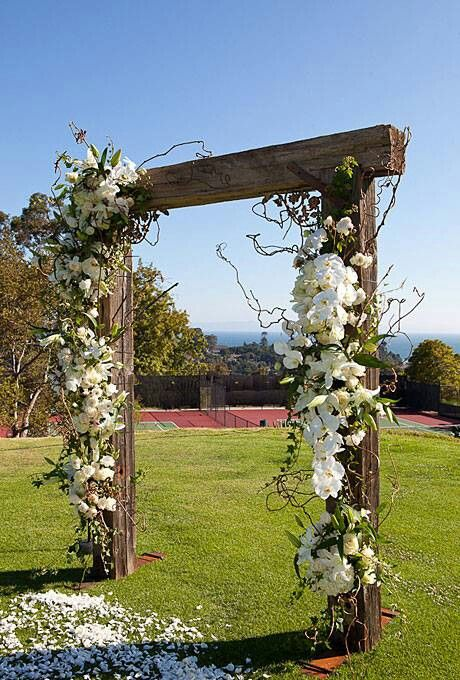 dress our ceremony spot like this with flowers & greenery, less sticks.... more elegant