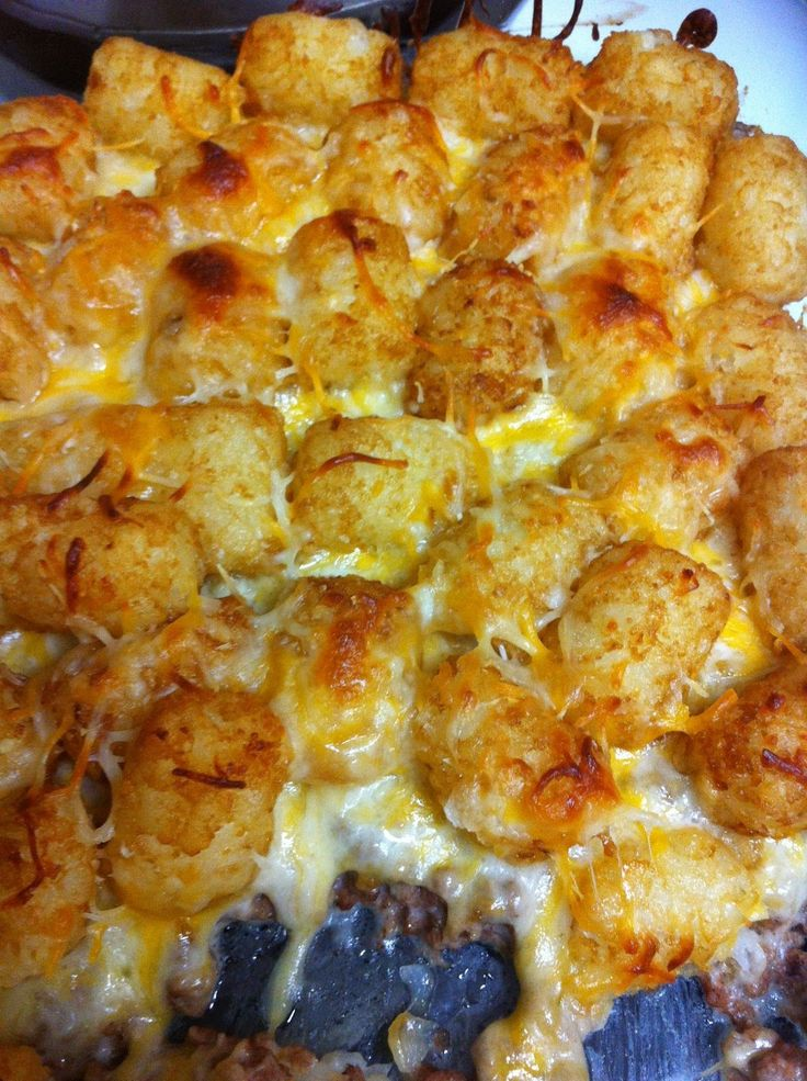 INGREDIENTS  1-2 lbs ground beef  1 can cream of mushroom  1 bag tater tots  shredded cheese   DIRECTIONS  (1) preheat oven to 375  (2) b...