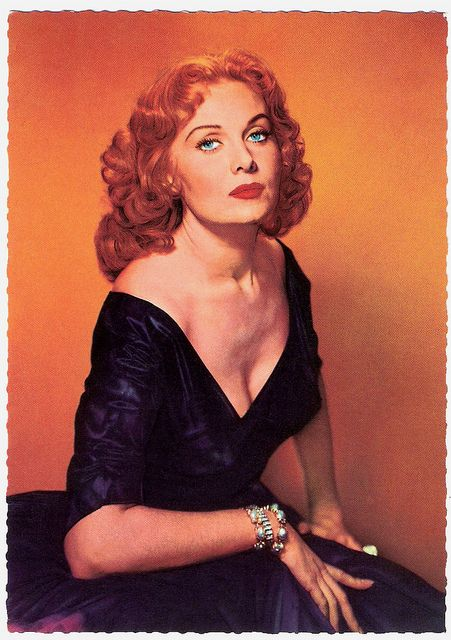 Beguilingly beautiful American film and television actress Rhonda Fleming in a studio portrait from the 1950s.