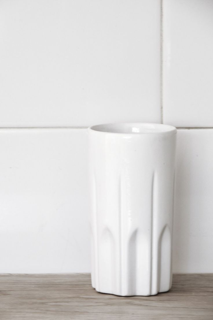 Although it is called a 'Tall Coffee Mug', this cleverly designed tall ceramic vessel without handles is anything but limited in its use. It can be used to serve beverages, hot or cold,…