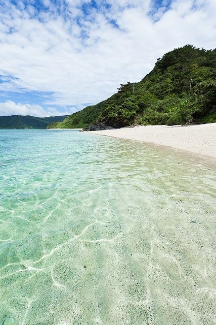 White sand beach and impossible clarity, Amami, Kagoshima, via Flickr.