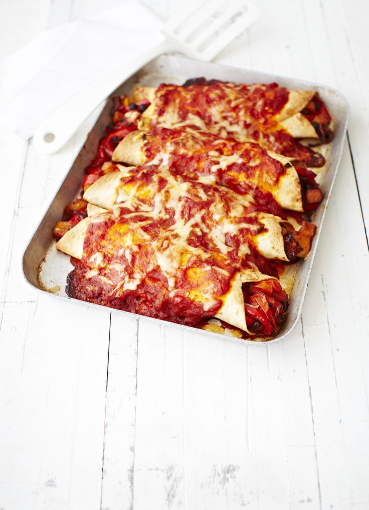 Roasted veg enchiladas: An easy vegetarian recipe for family and friends. Squash, tomatoes and onion in Tex-Mex spices, rolled into tortilla wraps and baked with a rich tomato sauce.