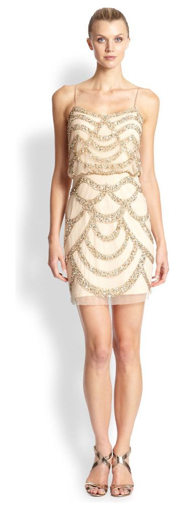 A mesh overlay adorned with beaded embellishments adds gleaming interest to this blouson dress. wel