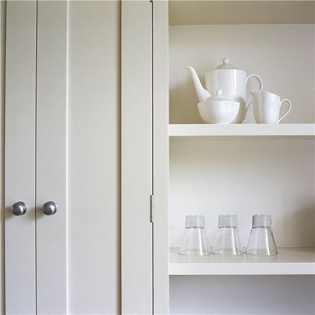I love a cabinet that is not a true white. Clunch by Farrow and Ball is a…