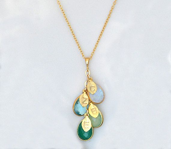 This is a beautiful cascading gemstone necklace with stamped metal charms that will gorgeously represent family or friends. This makes a perfect