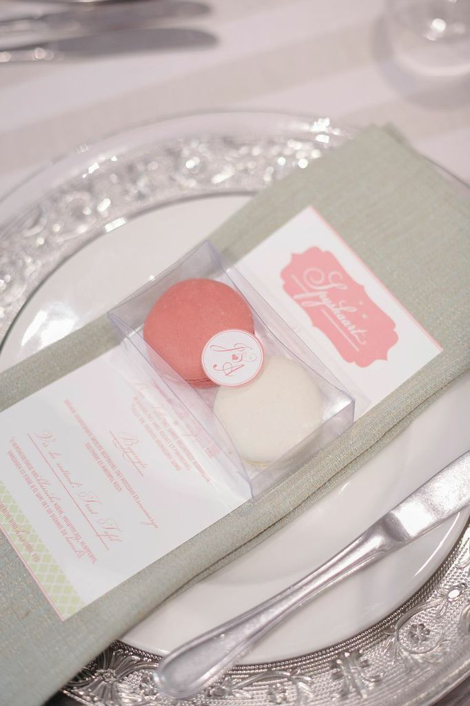 Favours and menu on mint green napkins