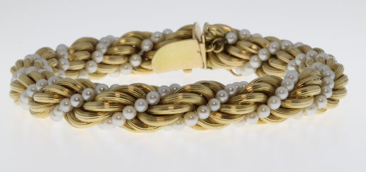 Lot 572, An 18ct yellow gold and seed pearl entwined bracelet, gross 38 grams, est £300-400